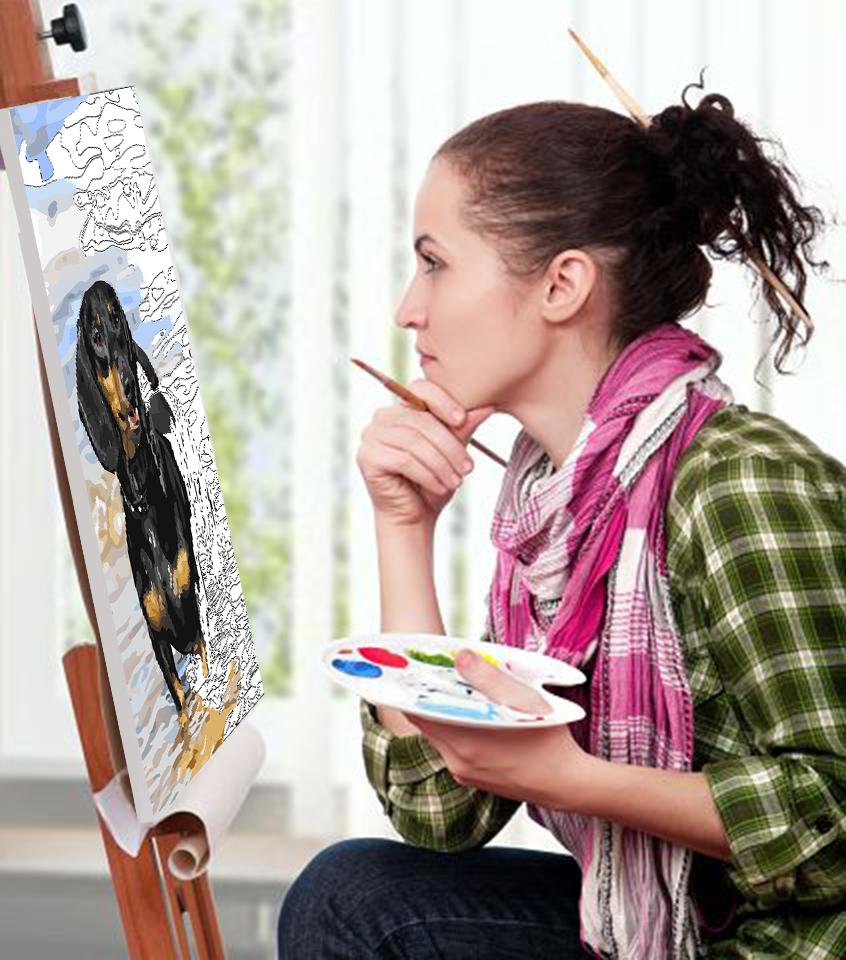 Девушка, рисующая картину с собакой